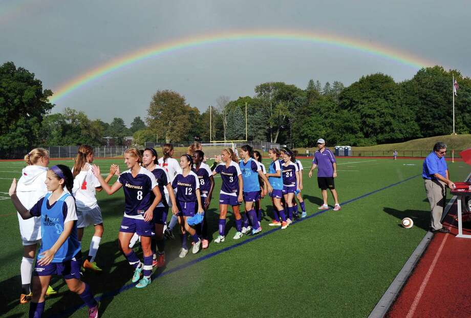 A rainbow appeared in the sky after a rain shower as the Greenwich High School girls varsity soccer team (in white) shook hands with the Westhill High School girls varisty soccer team (in purple) at the conclusion of the match that Westhill won, 1-0, at Greenwich High School, Friday, Sept. 13, 2013. Photo: Bob Luckey / Greenwich Time