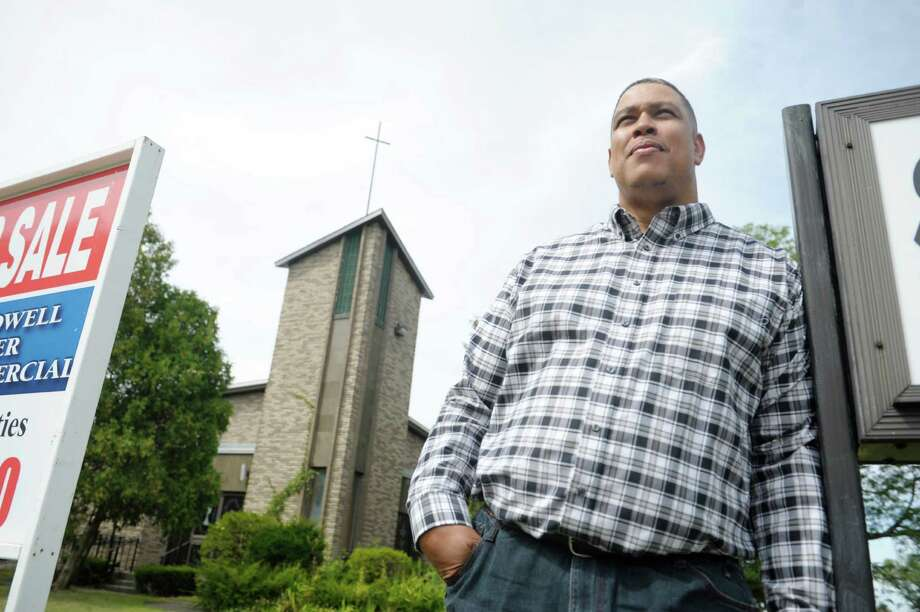 Church elder, Issac Gibbs with the Agape Apostolic Church of Deliverance, poses outside of the former St. Williams Church on Monday, Sept. 9, 2013 in Troy, NY.  Gibbs played a role in acquiring the new location.   (Paul Buckowski / Times Union) Photo: Paul Buckowski / 00023796A