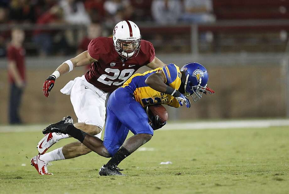 Stanford safety Ed Reynolds (29) tackles San Jose State wide receiver Tim Crawley (2) during the second half of an NCAA college football game in Stanford, Calif., Saturday, Sept. 7, 2013. (AP Photo/Tony Avelar) Photo: Tony Avelar, Associated Press