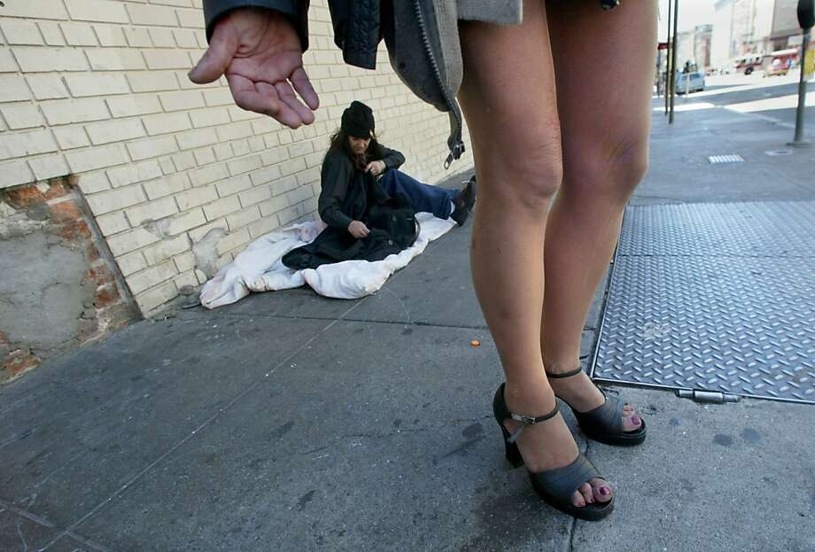 """outreach011_ward.jpg  Jill May has always been proud of her legs.  She says they helped her stay alive most of her life working as a prostitute on the streets.  Police used to call her """"legs"""", she says. In 2004, the city of San Francisco started to implement the Care Not Cash program.  One aspect of the program was to send outreach workers into the streets to contact the chronically homeless people and try to place them in hotel rooms.  On Jones Street in the Tenderloin, several homeless people were helped inside, while others proved more difficult. 6/1/04  Brant Ward Photo: Brant Ward, SFC"""