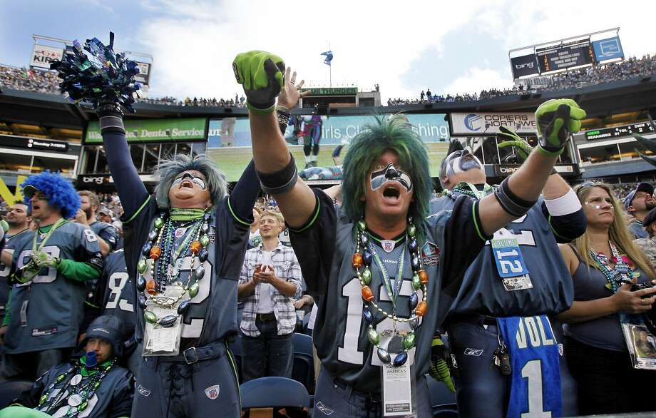 At top, perhaps channeling fans in the Oakland Coliseum's Black Hole section or Cleveland's Dawg Pound, some Seattle backers dress up for game days. Seahawks fans set a Guinness world record for loudest crowd at a sporting event in December. Photo: Elaine Thompson, Associated Press