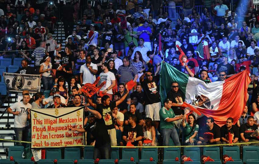 LAS VEGAS, NV - SEPTEMBER 13: Fans of Floyd Mayweather Jr. and Canelo Alvarez cheer as they wait for the official weigh-in for the bout between the boxers at the MGM Grand Garden Arena on September 13, 2013 in Las Vegas, Nevada. The fighters will meet in a WBC/WBA 154-pound title fight on September 14 in Las Vegas.