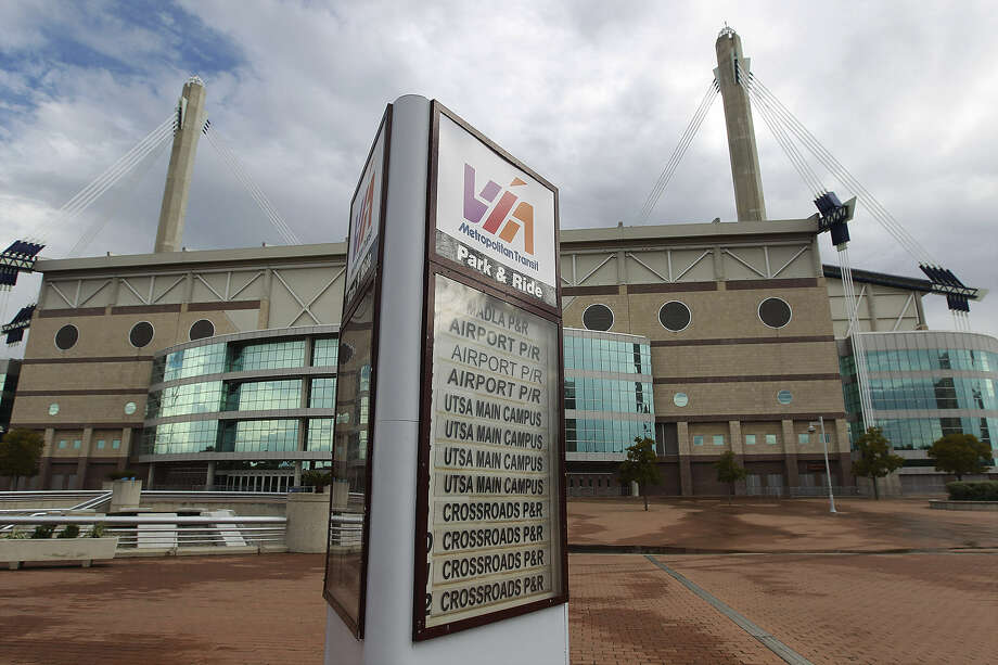 The Alamodome sits behind the Robert Thompson Transit Center along the proposed five-mile streetcar route. E-N readers are concerned the streetcar plan is misguided. Photo: Kin Man Hui / San Antonio Express-News