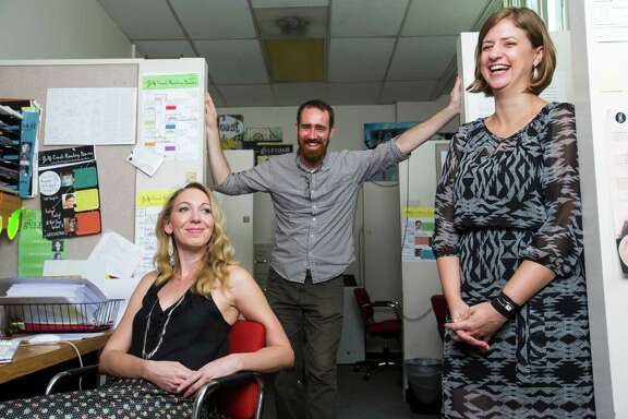"""Karyna McGlynn, managing editor of """"Gulf Coast: A Journal of Literature and Fine Arts"""", left, Zachary Martin, editor, and Amy Powell, Art Lies editor for """"Gulf Coast: A Journal of Literature and Fine Arts"""", Sept. 12, 2013 in Houston at the journal's office on the University of Houston campus. """"Gulf Coast"""" and """"Art Lies,"""" two of Houston's top arts journals, are merging, their inaugural publication slated for release by the end of October. """"Art Lies"""" recently suspended production. """"Gulf Coast: A Journal of Literature and Fine Arts"""", the literary review published at the University of Houston, will revive the core of Art Lies in its pages, but retain the Gulf Coast title. The result will be a twice-yearly journal that offers regional, national, and international exposure to the literary and visual arts cultures of Texas.   (Eric Kayne/For the Chronicle)"""