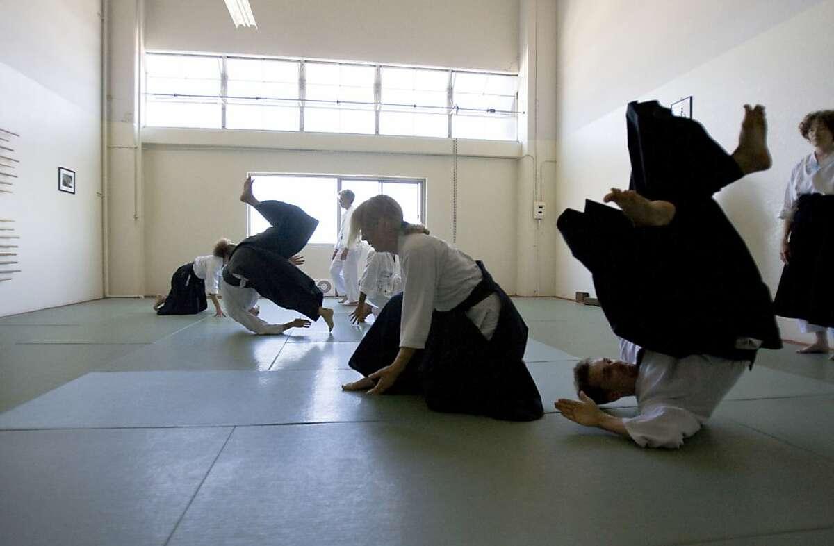 Linda Holiday throws Ian Nickols at Heart of San Francisco Aikido in San Francisco, Calif. on Sunday, Sept 8, 2013.