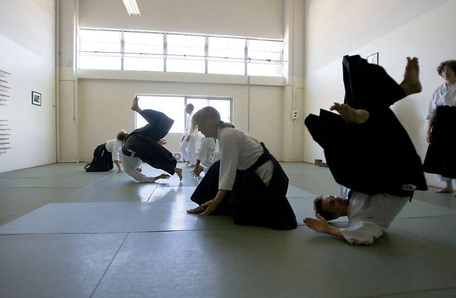 Linda Holiday, throwing Ian Nickols at Heart of San Francisco Aikido, says the martial art is not about power or aggression. Photo: Raphael Kluzniok, The Chronicle