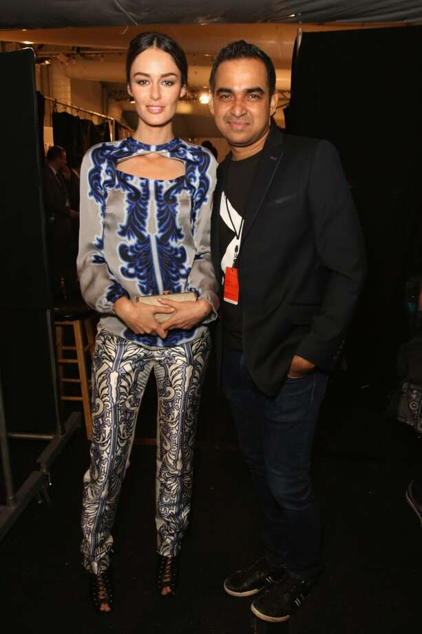 Designer Bibhu Mohapatra (R) and model Nicole Trunfio prepare backstage at the Bibhu Mohapatra fashion show during Mercedes-Benz Fashion Week Spring 2014 at The Studio at Lincoln Center on September 11, 2013 in New York City. Photo: Chelsea Lauren, (Credit Too Long, See Caption)
