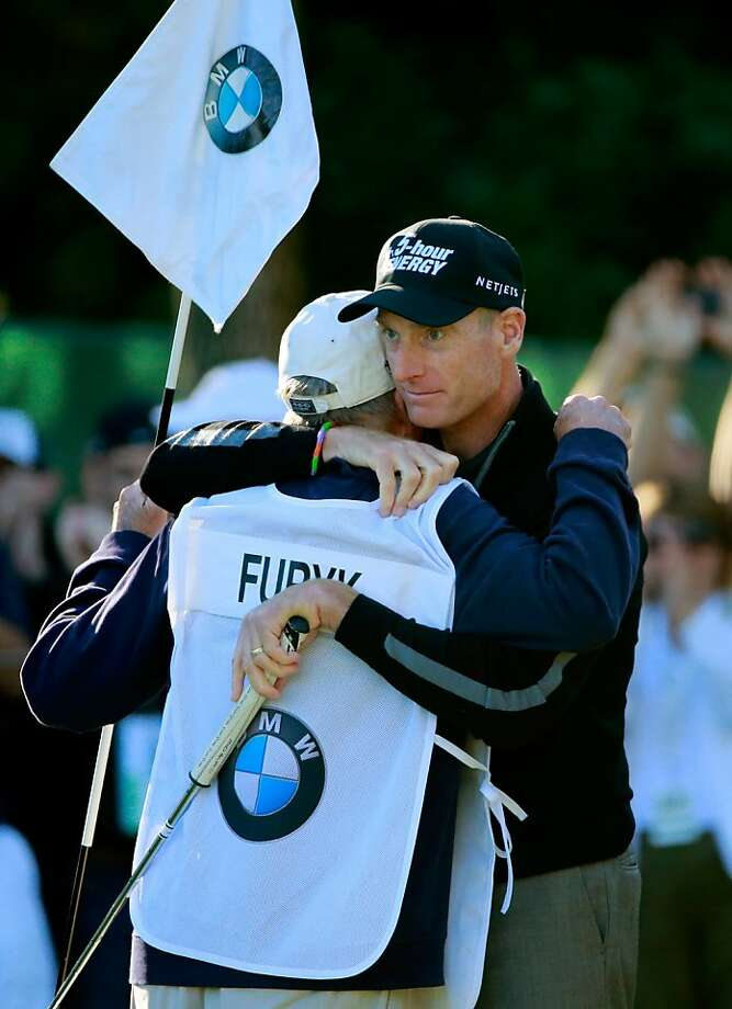 "Jim Furyk (right) embraces caddie Mike ""Fluff"" Cowan after the record-tying round. Photo: Sam Greenwood, Getty Images"