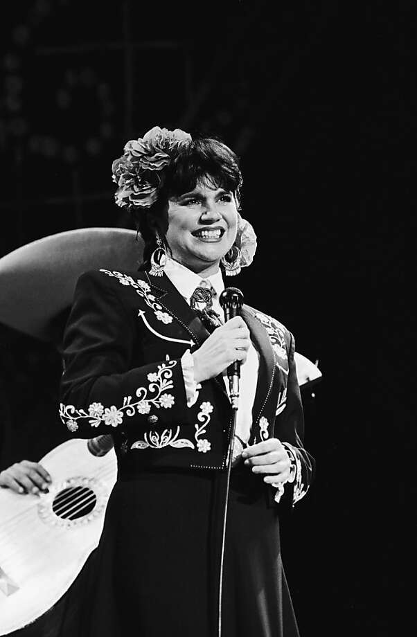 "Singer Linda Ronstadt belts out songs in Spanish from her ""Canciones de Mi Padre"" album at a 1988 Los Angeles, California, concert. Ronstadt won the 1988 Grammy Award for ""Best Mexican-American Performance."" (Photo by George Rose/Getty Images) Photo: George Rose"