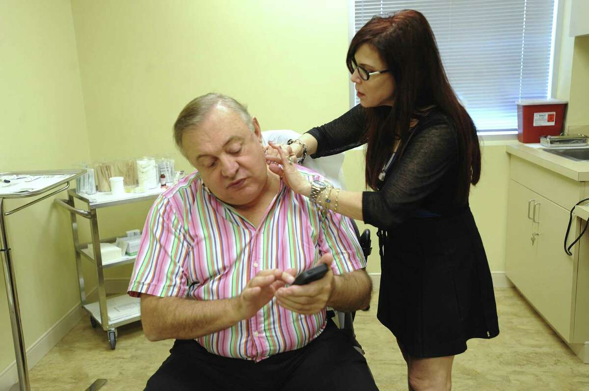 Dermatologist Vivian Bucay examines Sergio Mendez Torres, who lives in Mexico City, in her Stone Oak office. Bucay treats many patients from Mexico.