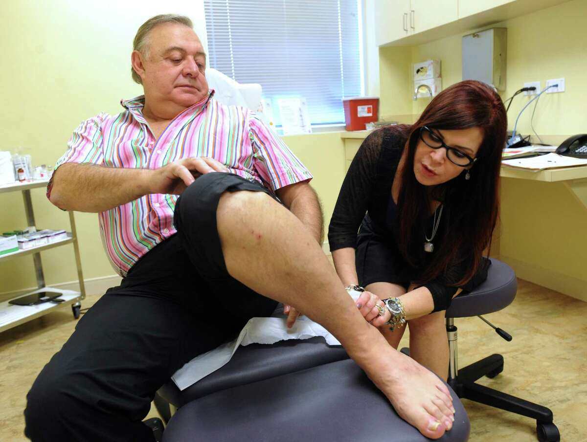 Dermatologist Dr. Vivian Bucay examines a skin blemish on Sergio Mendez Torres, who lives in Mexico City, in her Stone Oak area office on Wednesday, Sept. 12, 2013. Bucay treats many patients from Mexico.