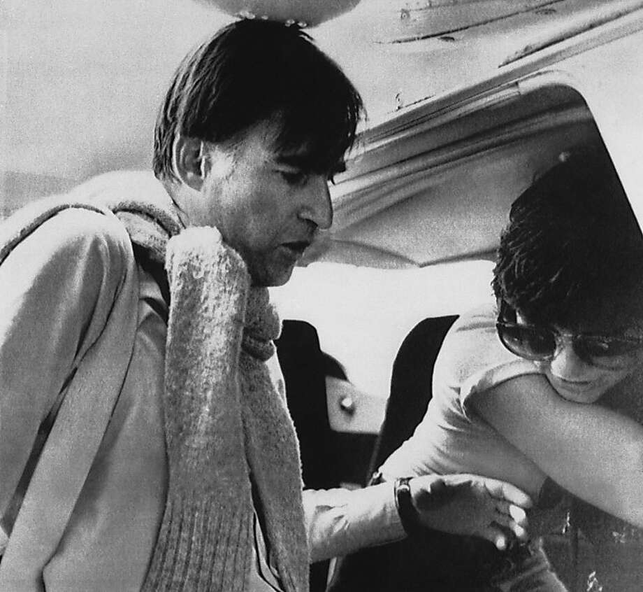California Gov. Jerry Brown helps rock star Linda Ronstadt board a small plane in Nairobi, Kenya, Tuesday, April 11, 1979. They were on a United Nations Environmental Program tour of a desertification project in northern Kenya. (AP Photo) Photo: Anonymous, AP