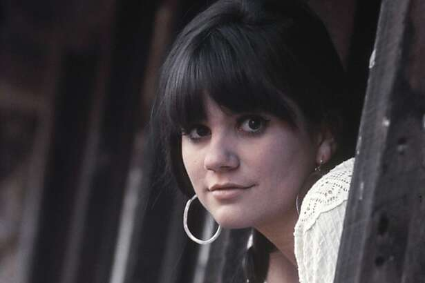 Singer Linda Ronstadt poses for a portrait for her first solo album 'Hand Sown ... Home Grown' on March 1, 1968 in Topanga, California.
