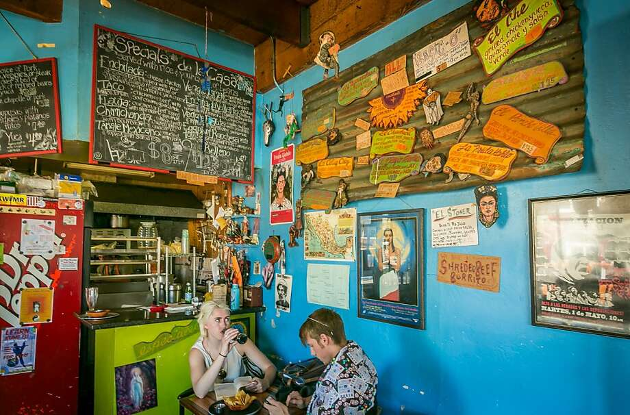 A couple enjoy lunch at Casa Mañana, above, with fare that includes the yucca bowl with rice, beans, a choice of chicken, pork, steak or vegetables and more, left, and pupusas con arroz y frijoles, below. Photo: John Storey, Special To The Chronicle