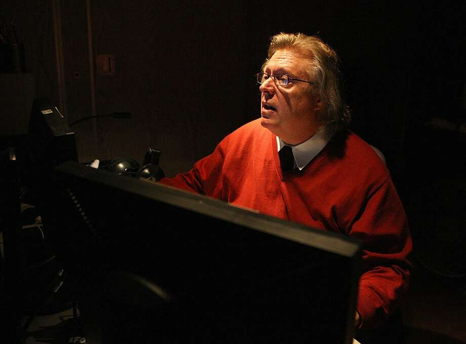 Steve White follows a score and carefully times supertitles for the opera, depending on the pace of the orchestra and singer. Photo: Liz Hafalia, The Chronicle