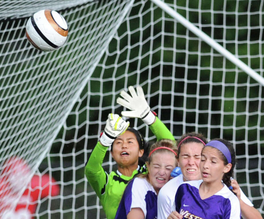 At left, Westhill goalie, Zhenna Stewart, blocks a Greenwich corner kick late in the second half during the girls varsity soccer match between Greenwich High School and Westhill High School at Greenwich, Friday, Sept. 13, 2013. Westhill defeated Greenwich, 1-0, on a goal by Jess Laszlo. Photo: Bob Luckey / Greenwich Time
