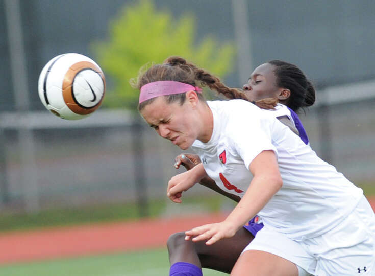 Caroline Markowitz of Greenwich heads the ball during the girls varsity soccer match between Greenwi