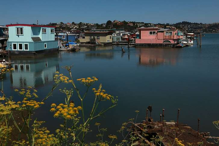 Houseboats in the background were built during the mid seventies in Sausalito, California, on Thursday, September 12, 2013.  This is how the houseboat community looked before permanent docks.  Many of these homes will soon be placed on a new dock with shore side amenities such as utilities and plumbing.  There is a five year plan in store for a new dock in the foreground.