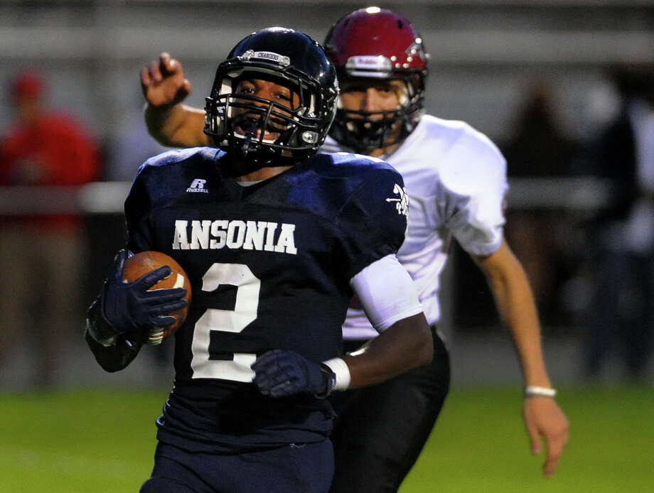 Ansonia's Arkeel Newsome glides into the endzone for a touchdown, during high school football action against Torrington in Ansonia, Conn. on Friday September 13, 2013. Photo: Christian Abraham / Connecticut Post