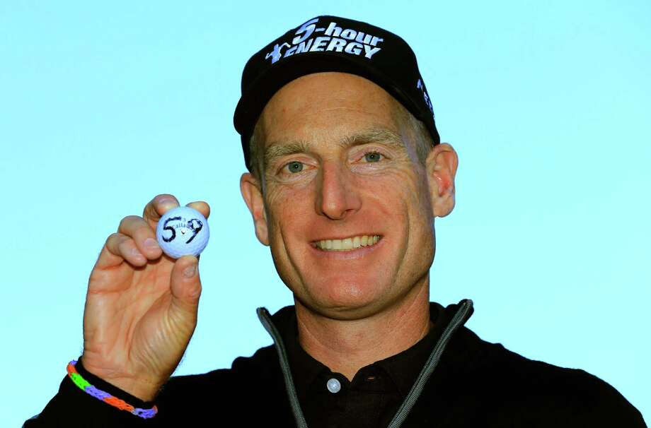 LAKE FOREST, IL - SEPTEMBER 13:  Jim Furyk holds up his ball with a '59' on it after shooting a 12 under round of 59 during the Second Round of the BMW Championship at Conway Farms Golf Club on September 13, 2013 in Lake Forest, Illinois.  (Photo by Sam Greenwood/Getty Images) ORG XMIT: 159810237 Photo: Sam Greenwood / 2013 Getty Images