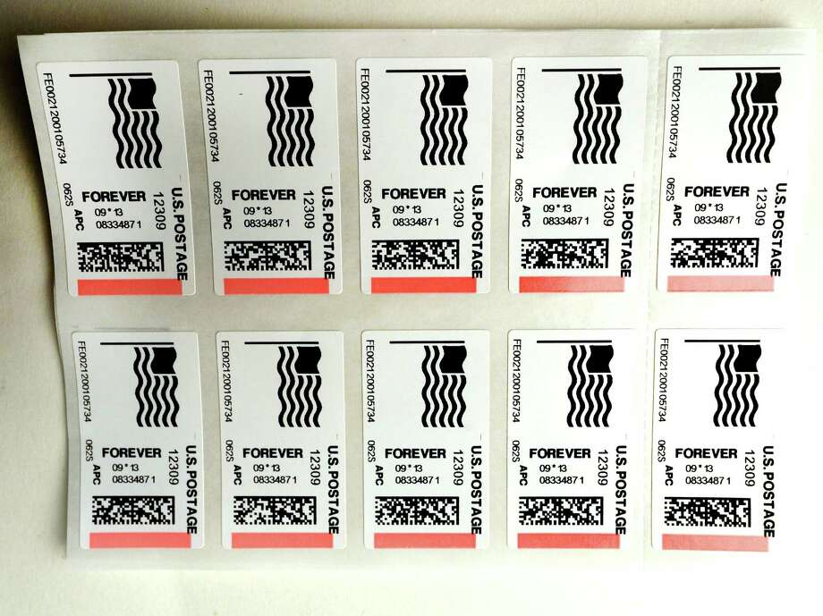 Forever stamps that were printed Friday afternoon, Sept. 13, 2013, by a postage sales machine at the Post Office in Niskayuna, N.Y.    (Skip Dickstein / Times Union) Photo: Skip Dickstein / 00023874A