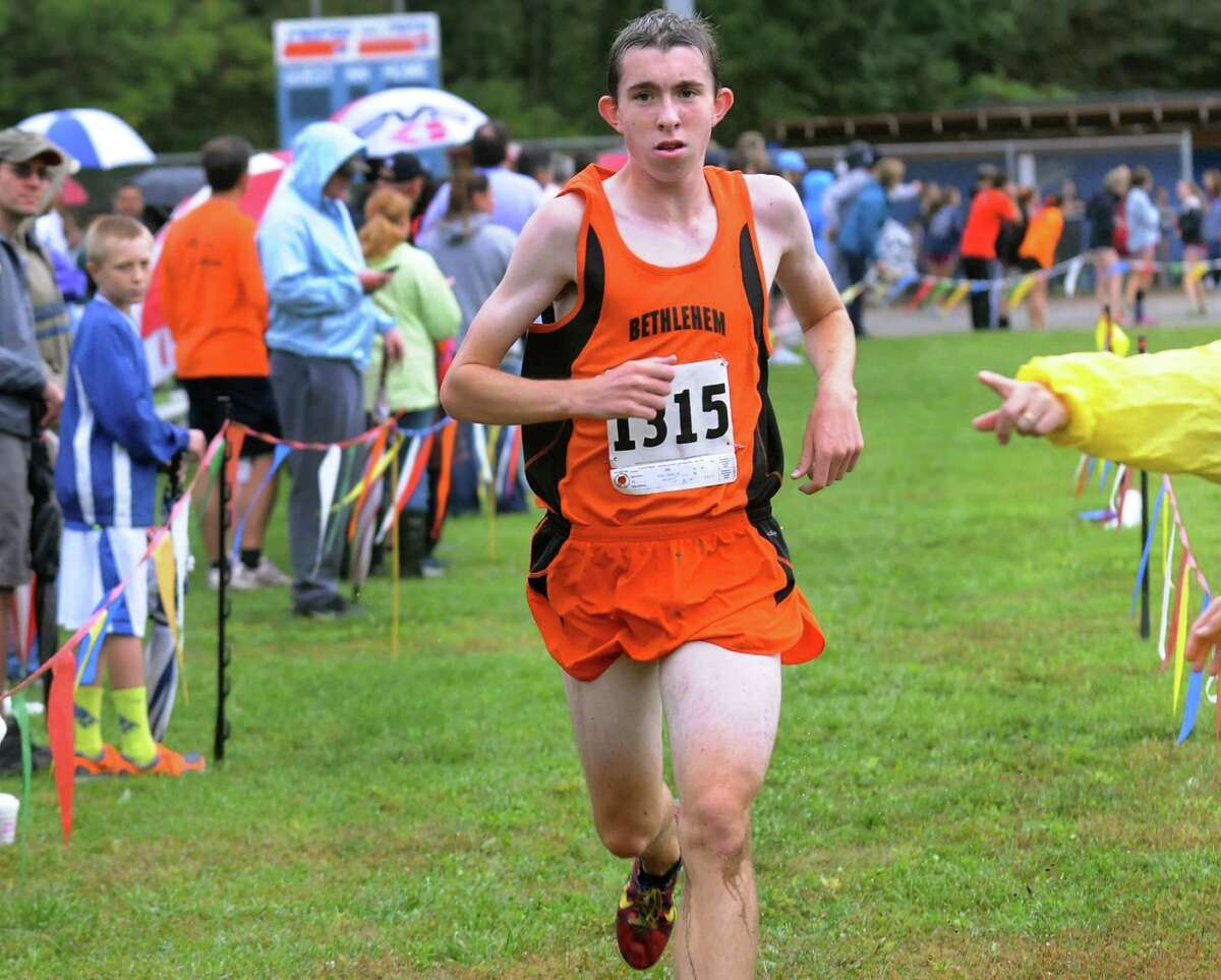 Bethlehem's Steve Booker crosses the finish line first during the Springstead Invitational cross country run on Friday, Sept. 13, 2013, at Colonie Town Park in Colonie, N.Y. (Cindy Schultz / Times Union)