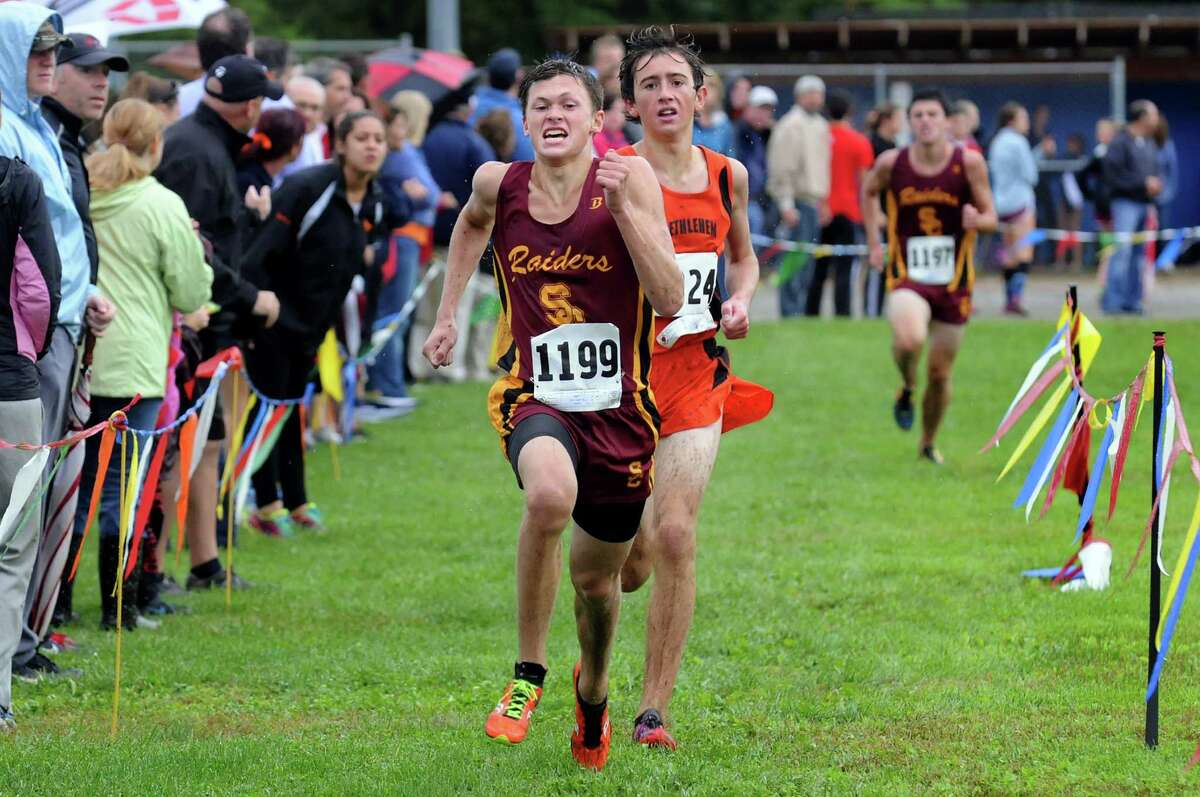 Colonie's Jordan Johnson, left, comes in ahead of Bethlehem's Alex Carlso, for second and third respectively, during the Springstead Invitational cross country run on Friday, Sept. 13, 2013, at Colonie Town Park in Colonie, N.Y. (Cindy Schultz / Times Union)