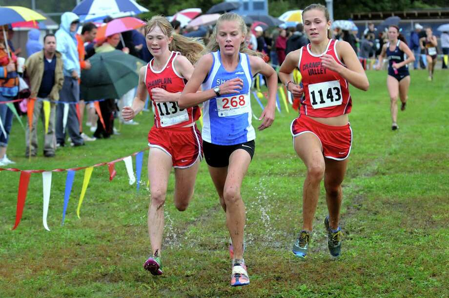 Shaker's Audrey Martino, center, runs neck-and-neck with Champlain Valley's Abby Keim, left, and Emma Putre during the Springstead Invitational cross country run on Friday, Sept. 13, 2013, at Colonie Town Park in Colonie, N.Y. (Cindy Schultz / Times Union) Photo: Cindy Schultz / 00023820A