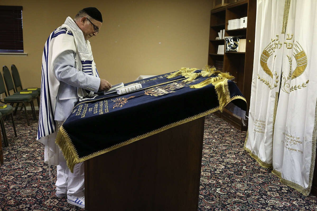 Cantor Isaac Elancry of Hollywood, Fla., prepares to lead a Yom Kippur service for Sephardic Jewish families on the grounds of the Chabad Center for Jewish Life and Learning in San Antonio.