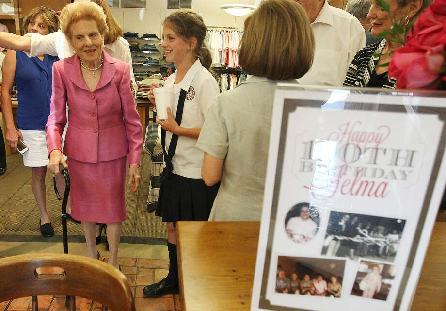 "Selma Satel greets well-wishers at her surprise 100th birthday party at Satel's. Next to her is great-granddaughter Ava Satel. ""It's been a good life,"" the longtime businesswoman said. ""It's been a lot of work, but I was happy with it. It's been very rewarding."" Photo: Kin Man Hui / San Antonio Express-News"
