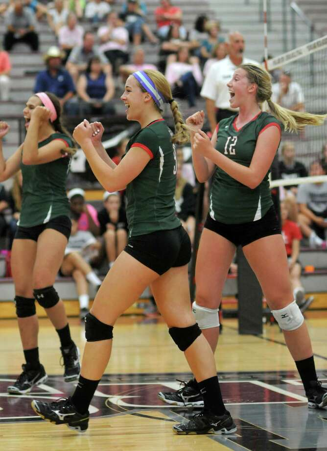 Senior Courtney Eckenrode, center, has led a lot of celebrations in her four years as a varsity setter for The Woodlands, which takes a 43-0 mark into state. Photo: Jerry Baker, Freelance