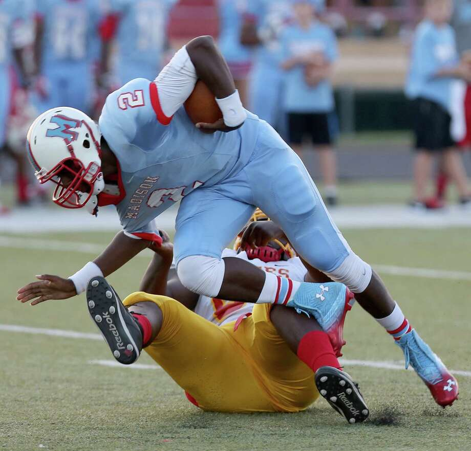 Madison's Cameron Davis is sacked by Yates' Deshawn Potts. Photo: Thomas B. Shea, For The Chronicle / © 2013 Thomas B. Shea