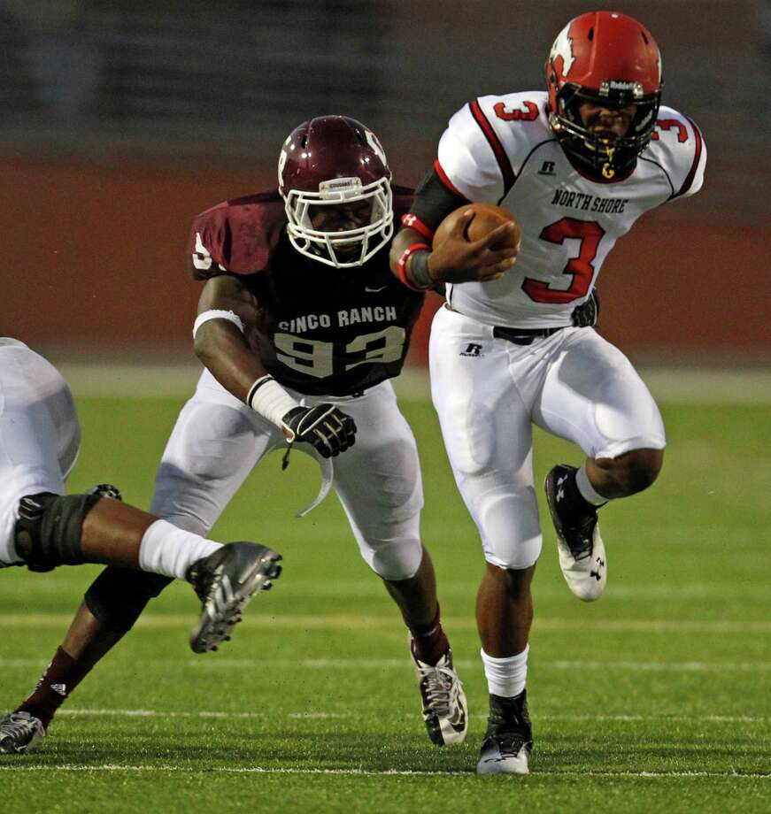 North Shore's Maciah Long (3) rushes past Cinco Ranch's Tobi Ilesanmi (93) during the first half of a high school football game, Friday,  September 13, 2013 at Rhodes Stadium in Katy. Photo: Eric Christian Smith, For The Chronicle