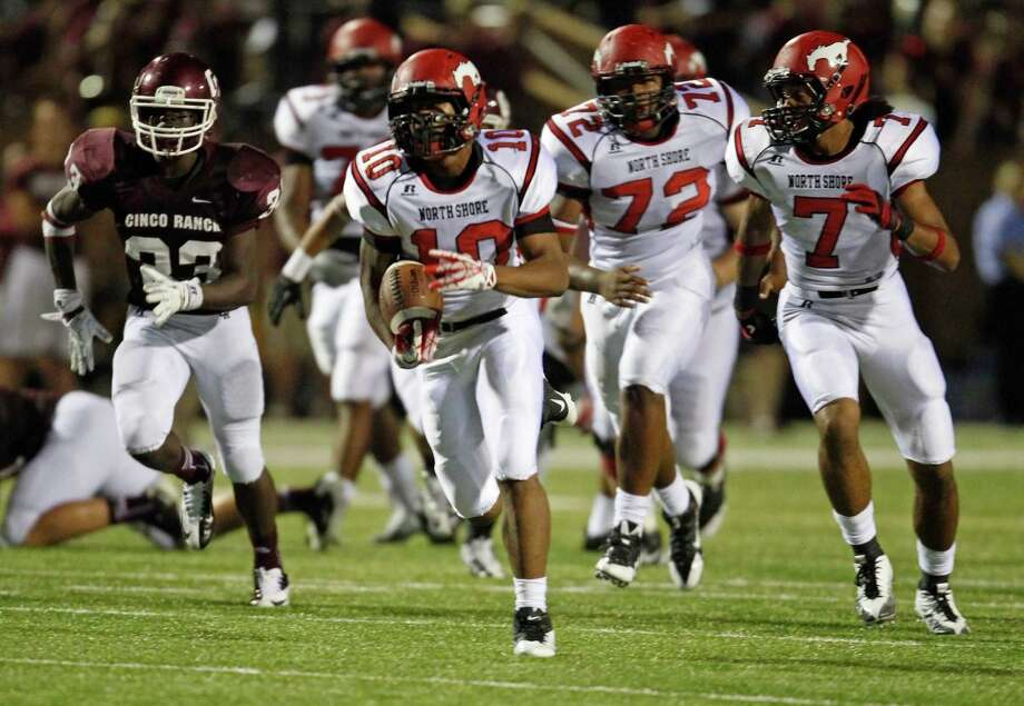 North Shore's Justin Green (10) scampers the ball upfield during the second half of a high school football game against North Shore, Friday, September 13, 2013 at Rhodes Stadium in Katy. Photo: Eric Christian Smith, For The Chronicle