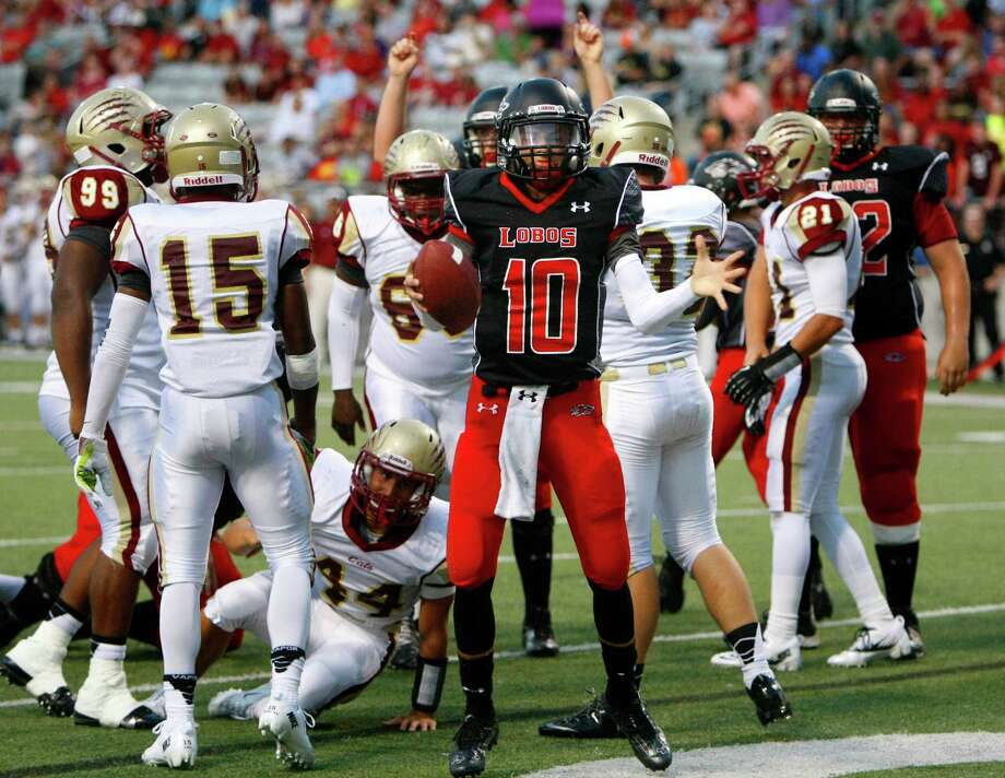 Langham Creek Lobos quarterback Kyle Cutbirth celebrates a touchdown during the first half of a football game against Cypress Woods at the Berry Center, Friday, Sept. 13, 2013, in Cypress. Photo: Cody Duty, Houston Chronicle / © 2013 Houston Chronicle