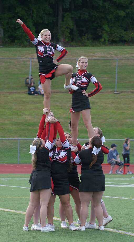 The Pomperaug Cheerleaders perform during halftime of friday's football game between Newtown and Pomperaug High Schools in Southbury, Conn, September 13, 2013. Photo: H John Voorhees III