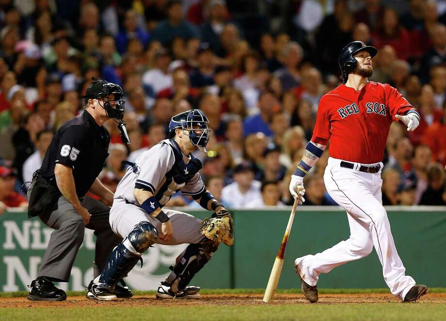 BOSTON, MA - SEPTEMBER 13: Jarrod Saltalamacchia #39 of the Boston Red Sox hits a grand-slam home run in the 7th inning against the New York Yankees during the game on September 13, 2013 at Fenway Park in Boston, Massachusetts. (Photo by Jared Wickerham/Getty Images) ORG XMIT: 163495512 Photo: Jared Wickerham / 2013 Getty Images
