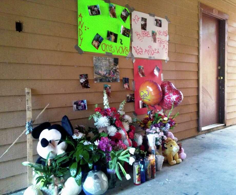 A makeshift memorial in honor of John Andrew Bermea, 20, has risen at Chisolm Trace Apartments. Photo: David G. Palacio / San Antonio Express-News