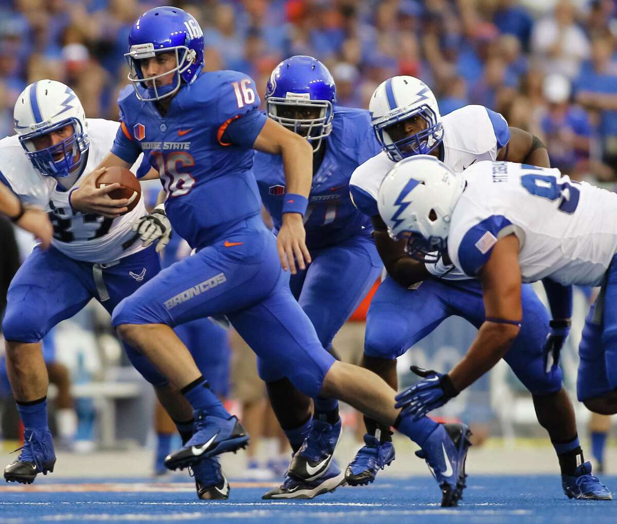 Boise State quarterback Joe Southwick, who was 27 of 29 passing for 287 yards, eludes three Air Force defenders.
