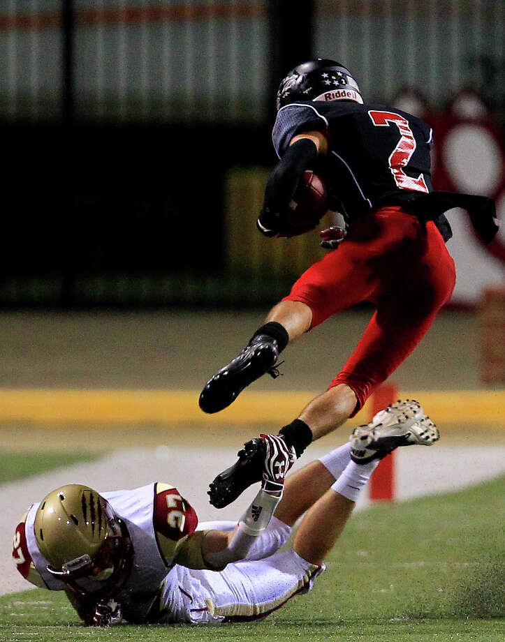 Langham Creek 48, Cypress Woods 20Cypress Woods defensive back Colton Fontana trips up Langham Creek wide receiver Tyler Williams during the second half. Photo: Cody Duty, Houston Chronicle / © 2013 Houston Chronicle