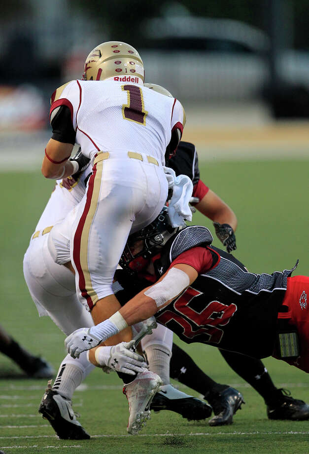 Cypress Woods wide receiver is tripped up by Langham Creek linebacker Nico Costanzo during the second half of their matchup at the Berry Center, Friday, Sept. 13, 2013, in Cypress. The Lobos won 48-20. Photo: Cody Duty, Houston Chronicle / © 2013 Houston Chronicle