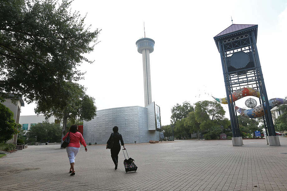 A report says the historic road cut through HemisFair Park, but no place in the park is that fact noted. Photo: Jerry Lara / San Antonio Express-News