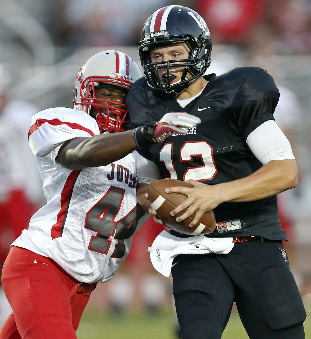 Judson's De'ontray Ellison sacks Churchill's Nate Pearson, who was held to 77 yards passing.