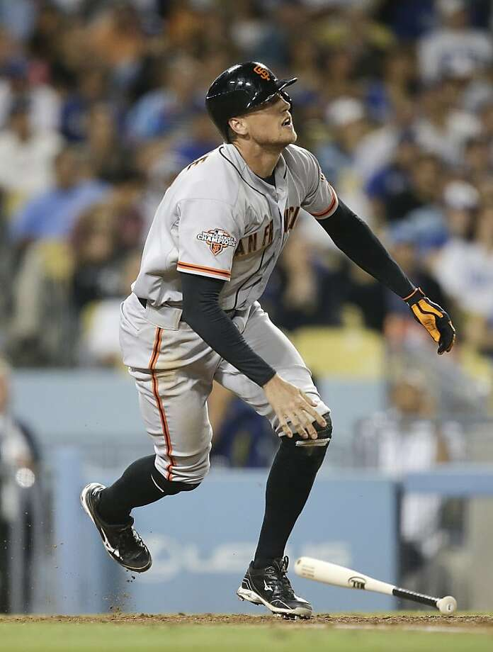 Hunter Pence follows the flight of his home run, a solo shot that put the Giants ahead 4-2. Photo: Jae C. Hong, Associated Press