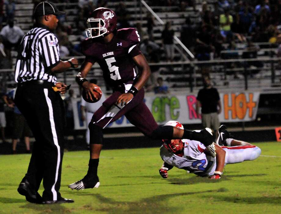 Patrick Reed scores the first touchdown for the Silsbee Tigers at Friday night's game. Photo: Cassie Smith