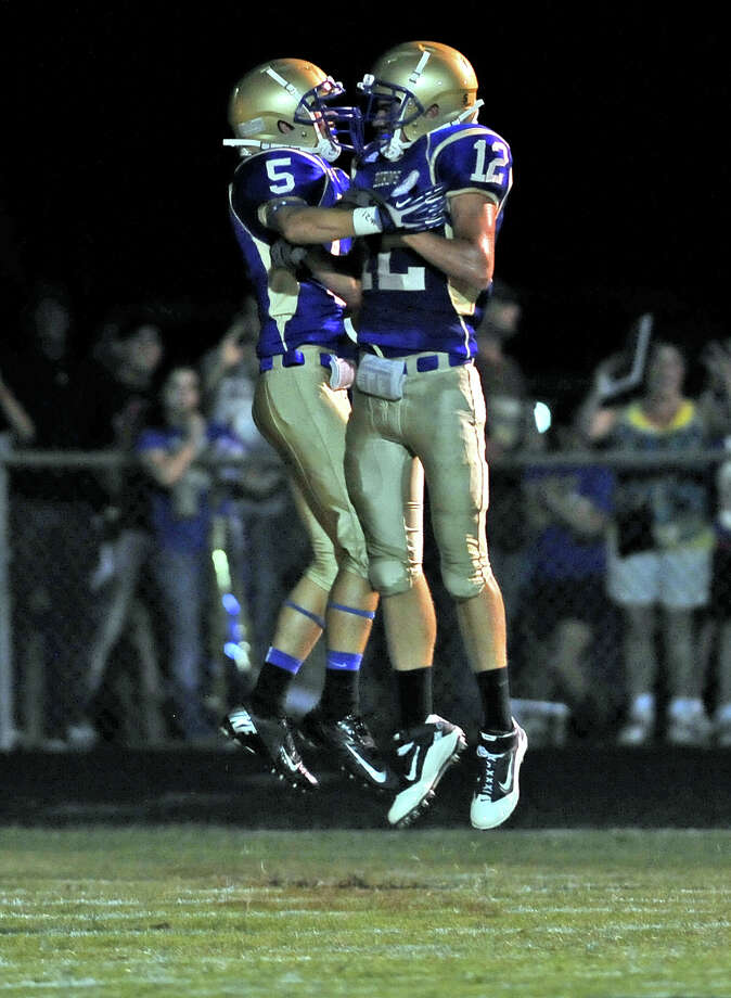 Hamshire-Fannett ISDHamshire-Fannett High SchoolGraduation: 7 p.m. June 6 at Ford Park(File photo) H-F players Chris Jolley, #5, and Dalton Bushnell, #12, celebrate a touchdown during the Hamshire-Fannett High School homecoming game against East Chambers High School on Friday, September 13, 2013. Photo taken: Randy Edwards/The Enterprise Photo: Randy Edwards, Photojournalist / Enterprise