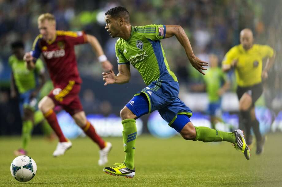 Lamar Neagle, center, makes a move toward the Real Salt Lake goal during the second half of a game Friday, September 13, 2013, at CenturyLink Field in Seattle. The Sounders beat Real Salt Lake 2-0. With over 52,000 tickets distributed, the Sounders put their 12-game home unbeaten streak on the line during the face-off with Real Salt Lake. (Jordan Stead, seattlepi.com) Photo: JORDAN STEAD, SEATTLEPI.COM