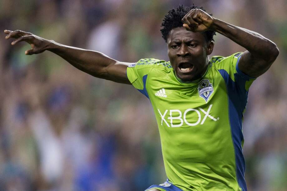 Obafemi Martins rejoices after scoring the first goal of the game against Real Salt Lake Friday, September 13, 2013, at CenturyLink Field in Seattle. The Sounders led Real Salt Lake 2-0 at the half. With over 52,000 tickets distributed, the Sounders put their 12-game home unbeaten streak on the line during the face-off with Real Salt Lake. (Jordan Stead, seattlepi.com) Photo: JORDAN STEAD, SEATTLEPI.COM