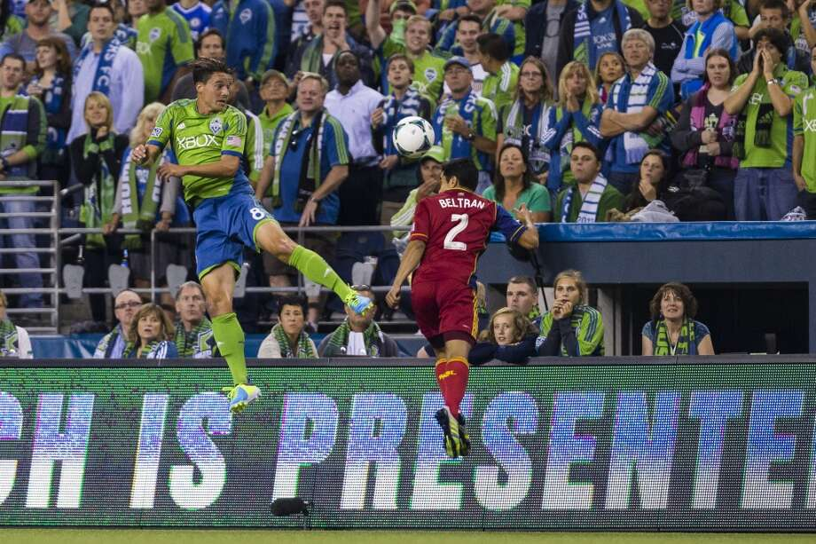 Marc Burch, left, and Tony Beltran, right, go up for a header during the first half of a game Friday, September 13, 2013, at CenturyLink Field in Seattle. The Sounders led Real Salt Lake 2-0 at the half. With over 52,000 tickets distributed, the Sounders put their 12-game home unbeaten streak on the line during the face-off with Real Salt Lake. (Jordan Stead, seattlepi.com) Photo: JORDAN STEAD, SEATTLEPI.COM
