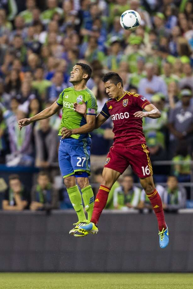 Lamar Neagle, left, and Carlos Salcedo, right, go up for a header during the first half of a game Friday, September 13, 2013, at CenturyLink Field in Seattle. The Sounders led Real Salt Lake 2-0 at the half. With over 52,000 tickets distributed, the Sounders put their 12-game home unbeaten streak on the line during the face-off with Real Salt Lake. (Jordan Stead, seattlepi.com) Photo: JORDAN STEAD, SEATTLEPI.COM